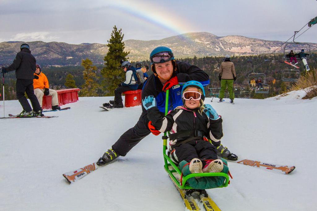 happy sit skiier